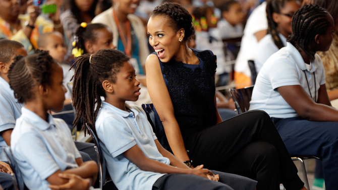 WASHINGTON, DC - MAY 24: Actress Kerry Washington sits with students during an event while visiting the Savoy School with U.S. first lady Michelle Obama May 24, 2013 in Washington, DC. The Savoy School, once one of the lowest performing schools in the District of Columbia, has shown significant signs of improvement since being designated as one of eight schools selected last year for the Turnaround Arts Initiative by the President's Committee on the Arts and the Humanities. (Photo by Win McNamee/Getty Images)