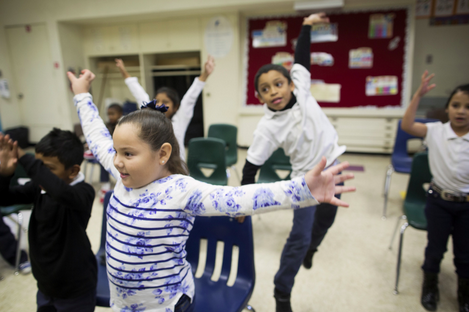 First-graders Valeria Beltran, left, and Jarret Moore take part in a music class at Martin Luther King Jr. Elementary School in Compton on Friday, Dec. 5, 2014. The class is supported by Turnaround Arts, a national program that brings arts education to high-poverty elementary and middle schools. MAYA SUGARMAN/KPCC